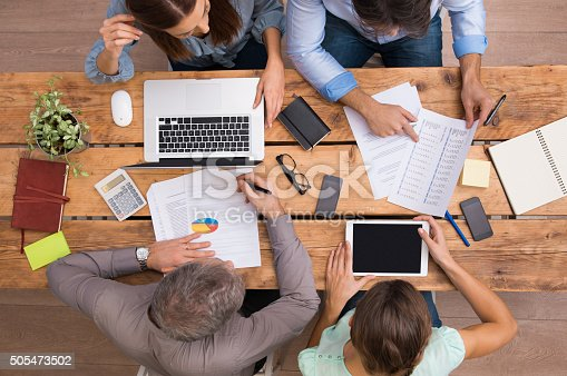 istock Business people working on desk 505473502