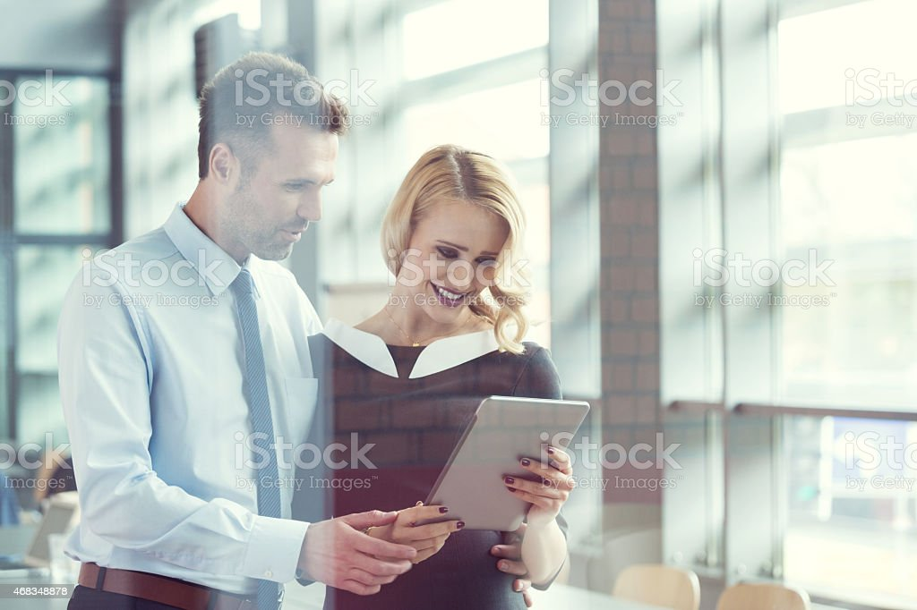 Business people working on digital tablet in an office royalty-free stock photo