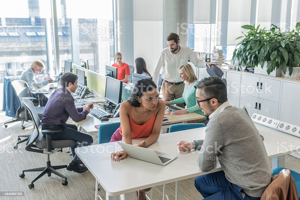 Business people working on laptop in modern office stock photo