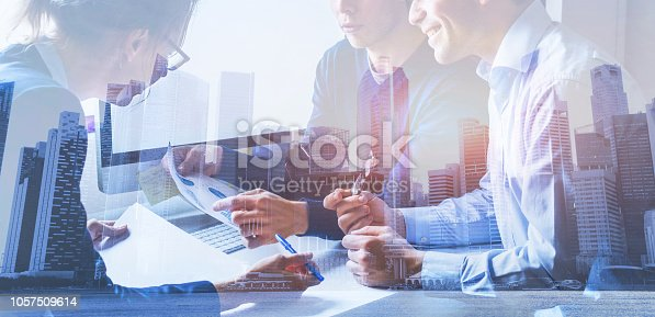 istock business people working on marketing plan, double exposure 1057509614