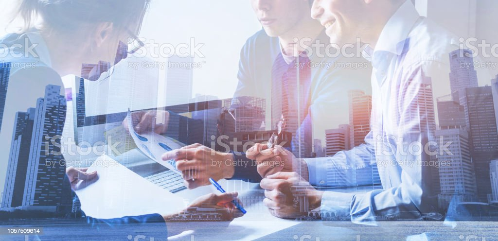 business people working on marketing plan, double exposure stock photo