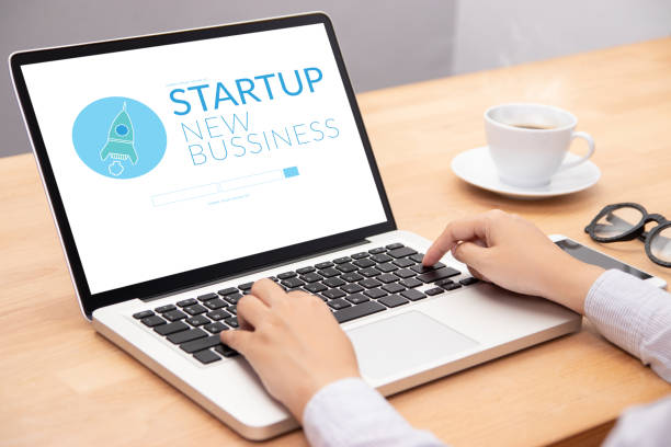 business people working on notebook laptop computer with startup business and rocket logo on screen, start up ideas business development - rocket logo stock photos and pictures