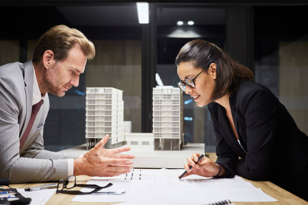 Business people working on plan at desk stock photo