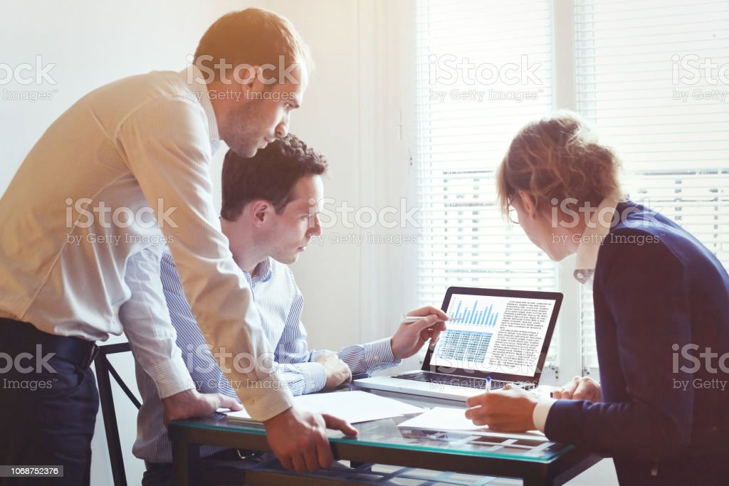 business people working on project together in the office, teamwork concept stock photo