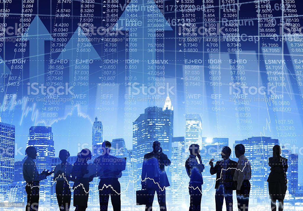 Business People Working Outdoors with Financial Figures stock photo