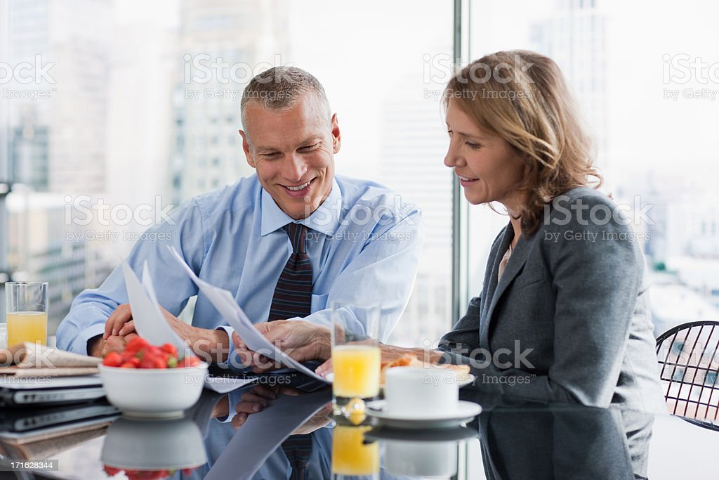 Business people working over breakfast royalty-free stock photo