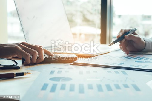 927401824 istock photo Business people working together and analysis summary report chart on table at office room. 927401824