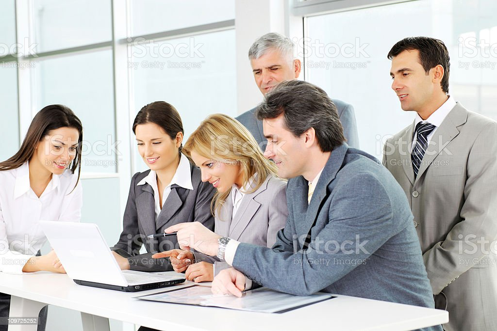 Business people working together at laptop computer and discuss royalty-free stock photo