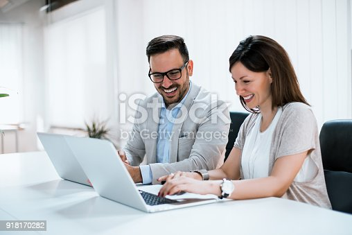istock Business people working together in bright office, sitting at desk. 918170282