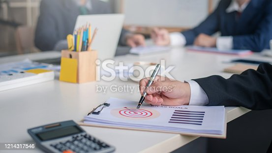 935757718 istock photo Business people working together in the office. 1214317546