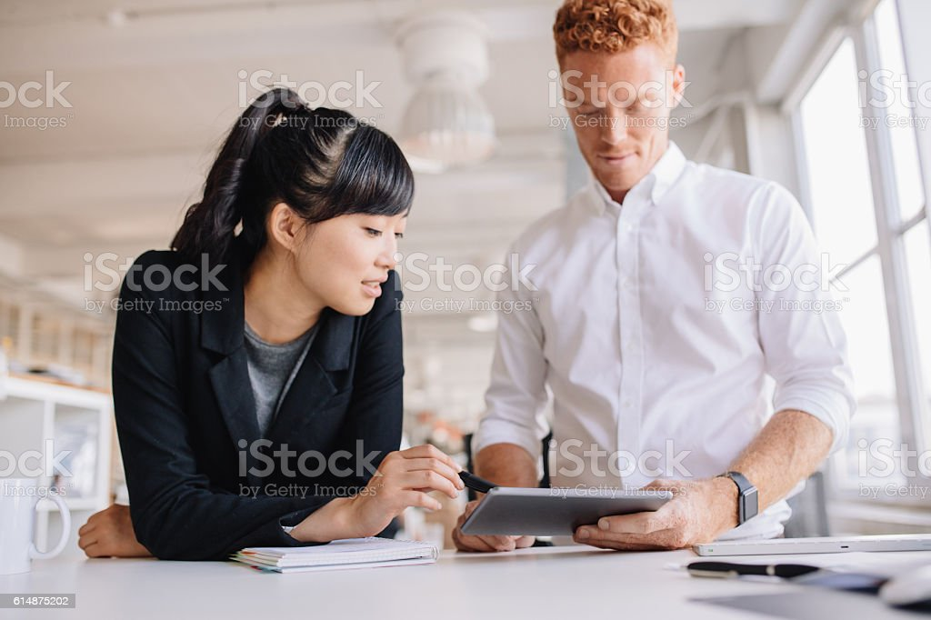 Business people working together on digital tablet stock photo