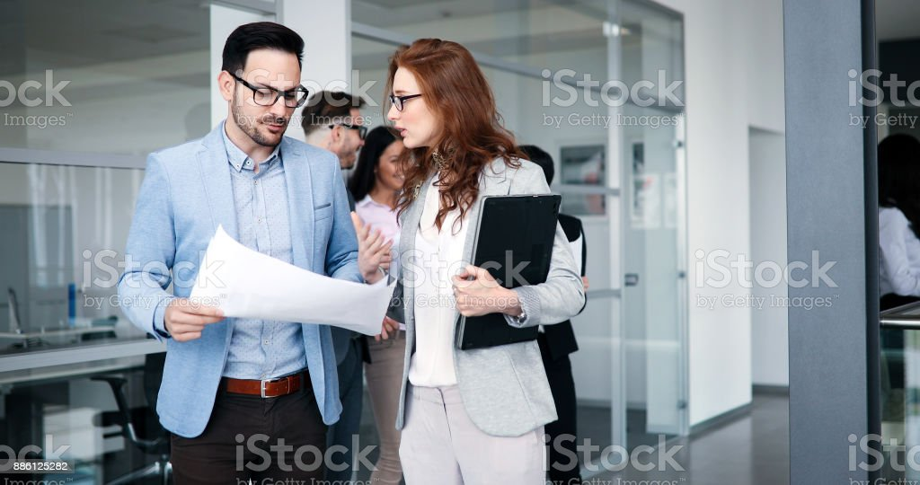 Business people working together on project Business people working together on project and brainstorming in office Adult Stock Photo