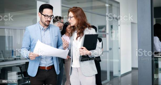 Business People Working Together On Project Stock Photo - Download Image Now