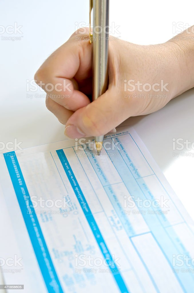 business people writing the pen on deposit slip royalty-free stock photo