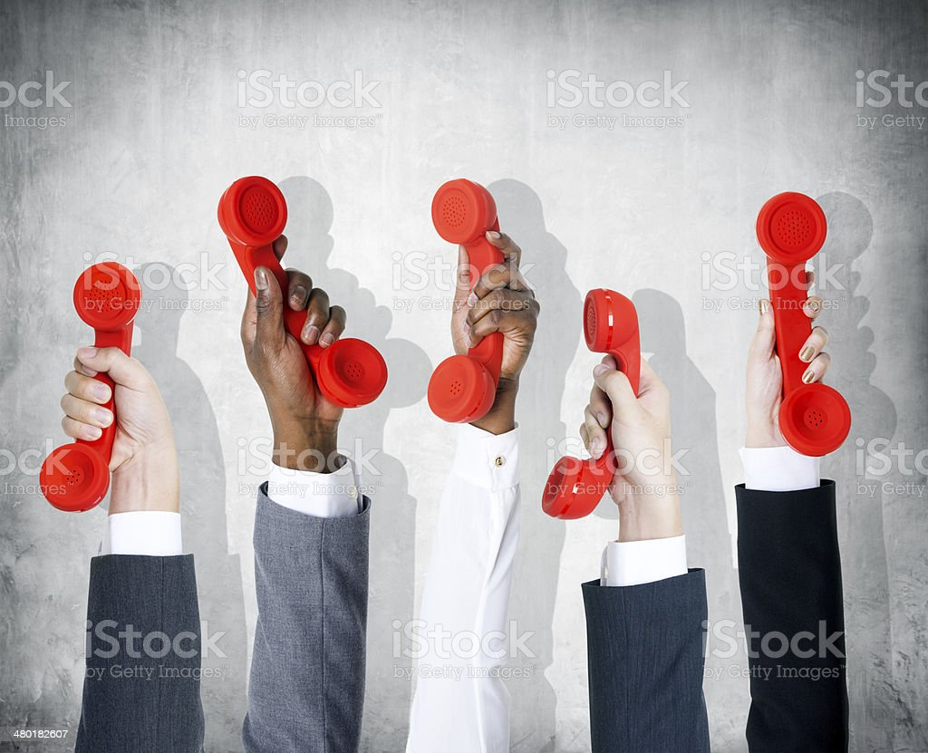 Business People's Hands Holding the Red Phone stock photo