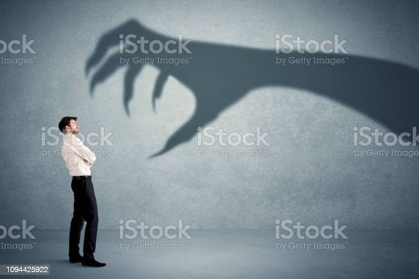 Business person afraid of a big monster claw shadow concept picture id1094425922?b=1&k=6&m=1094425922&s=612x612&h=adc stv7wxqvbxcqkctet4wykuk 2rmoyce 6khot3e=