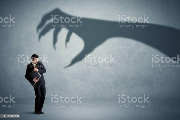 Business person afraid of a big monster claw shadow concept picture id961201820?b=1&k=6&m=961201820&s=612x612&h=yxtzlrnr94iwijdaegmaoml2rqkcszbhji1jcvffgui=