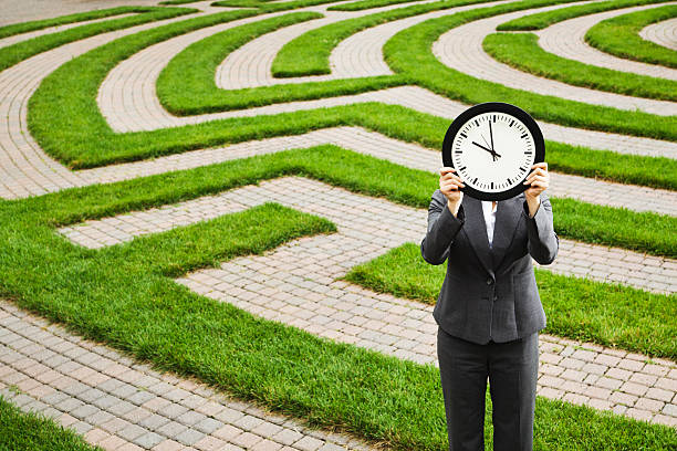 Business Person Facing Time Deadline, Lost in Corporate Employment Maze stock photo