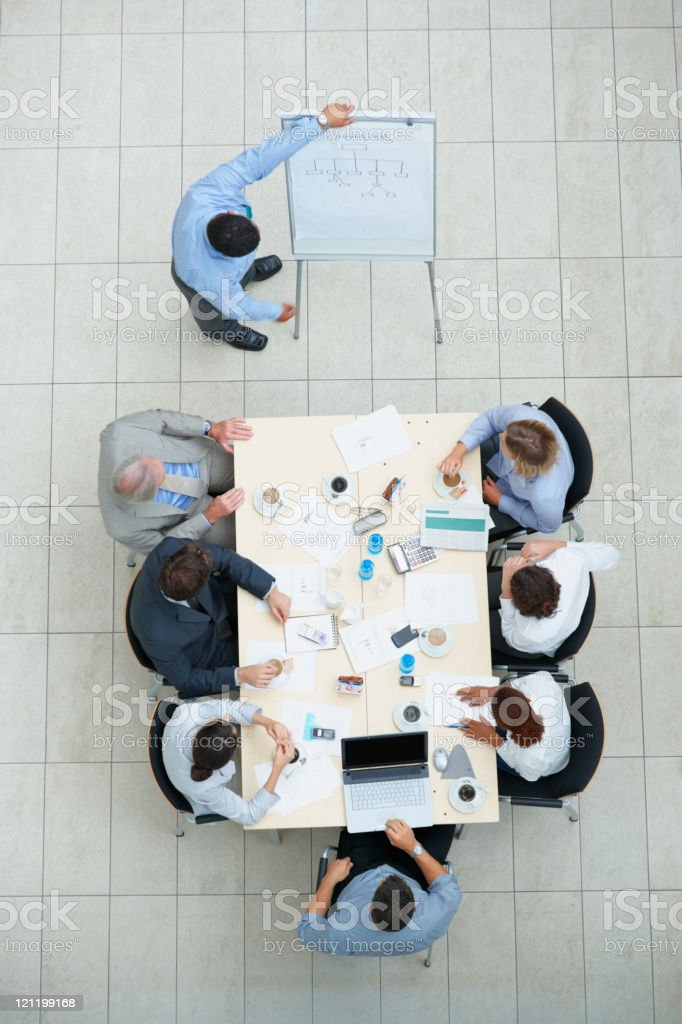 Business person giving his presentation to colleagues royalty-free stock photo