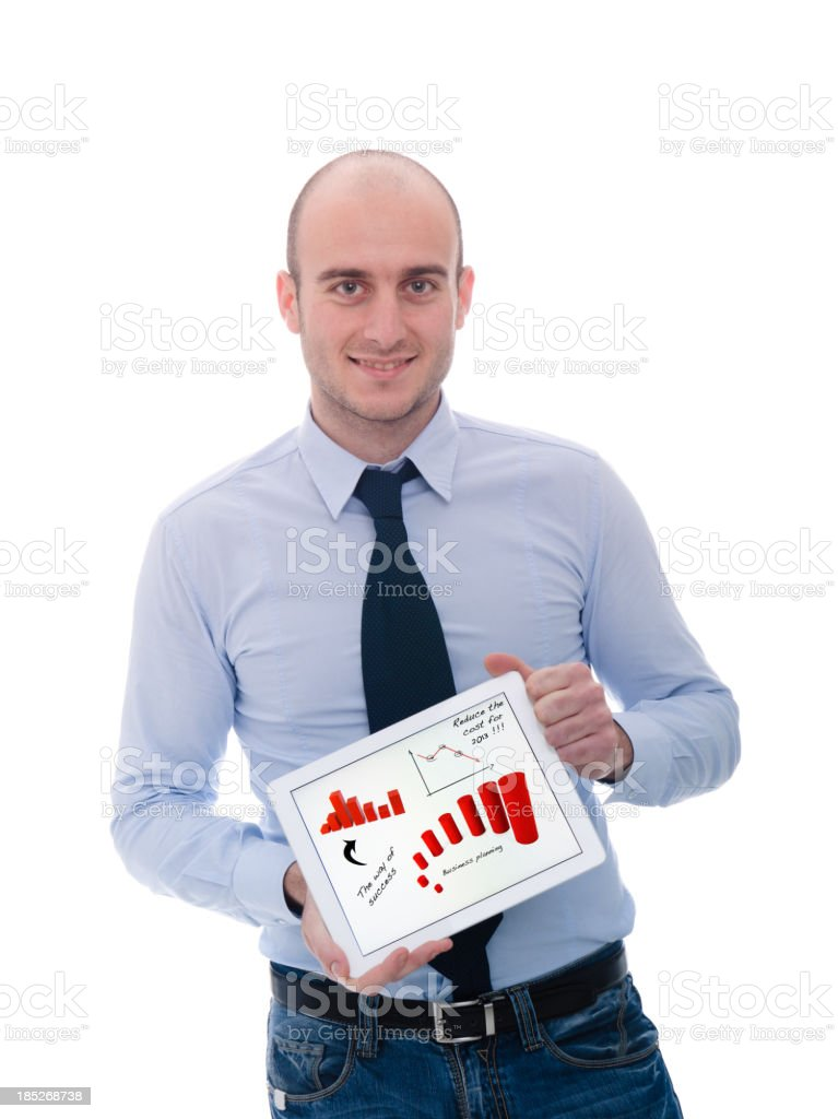 Business person holding a digital tablet with marketing graph royalty-free stock photo