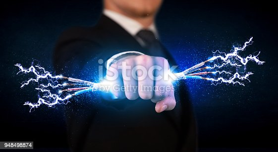 istock Business person holding electrical powered wires 948498874