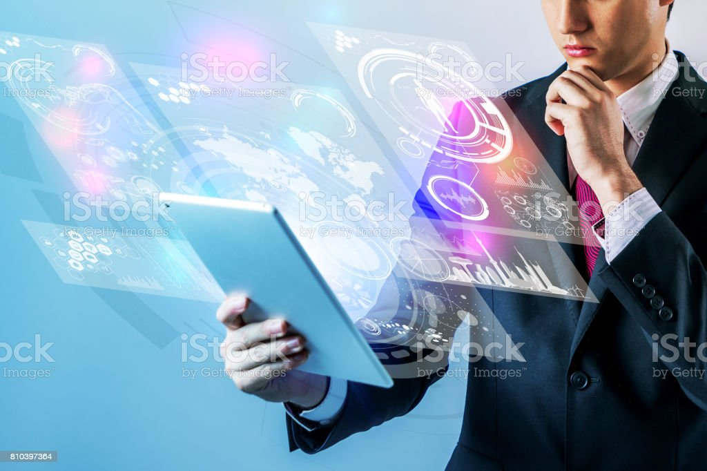 business person holding futuristic tablet PC stock photo