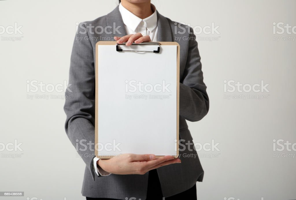 business person holds a clipboard foto de stock royalty-free