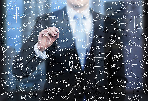 business person is writing down math formulas stock photo
