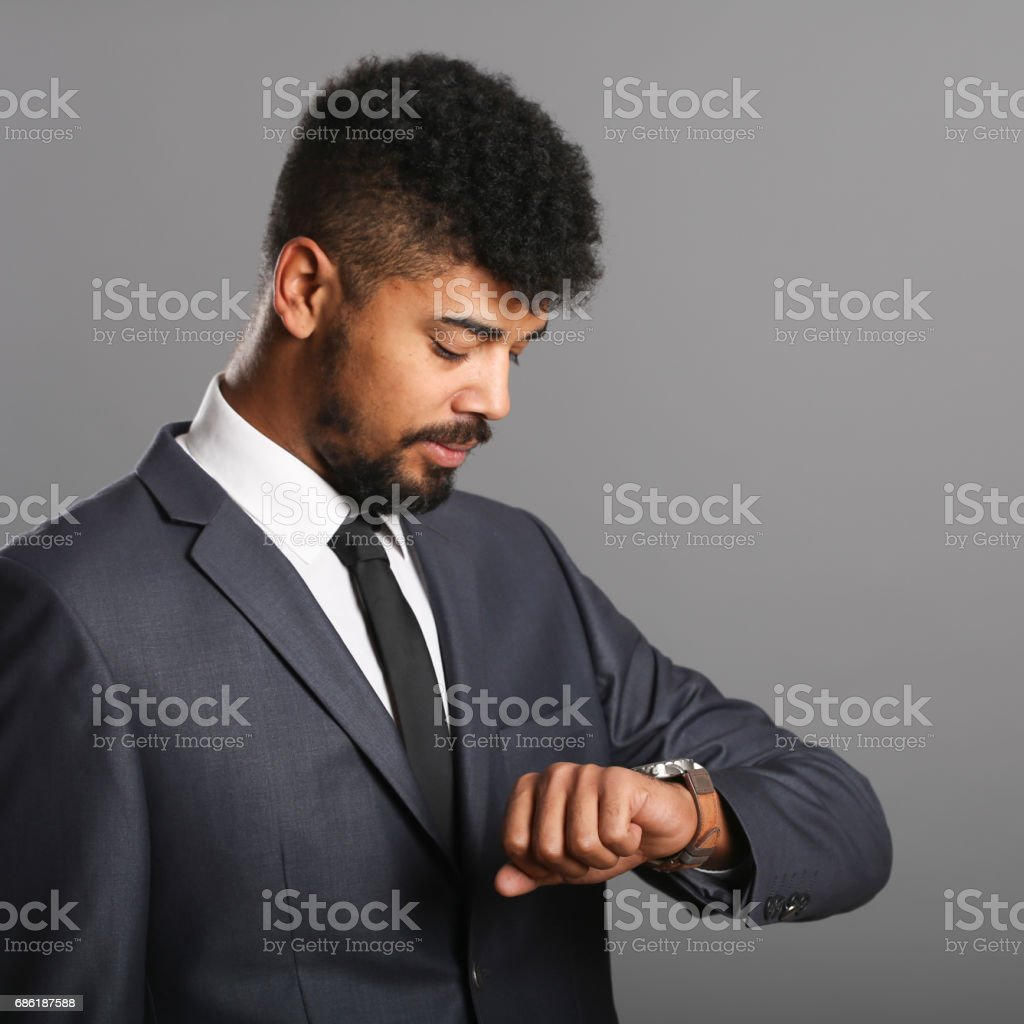 Business person looking at his wristwatch stock photo