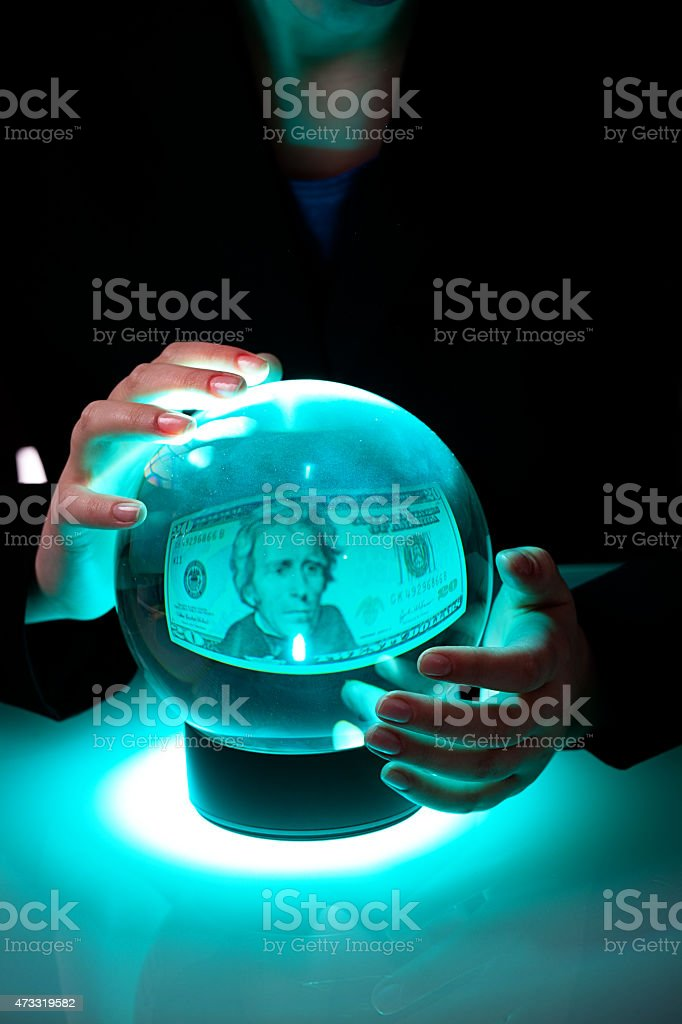 Business Person Looking into Crystal Ball, Forecasting Future Financial Wealth stock photo