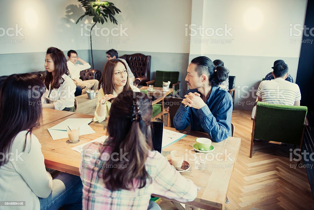 Business person meeting in a cafe stock photo