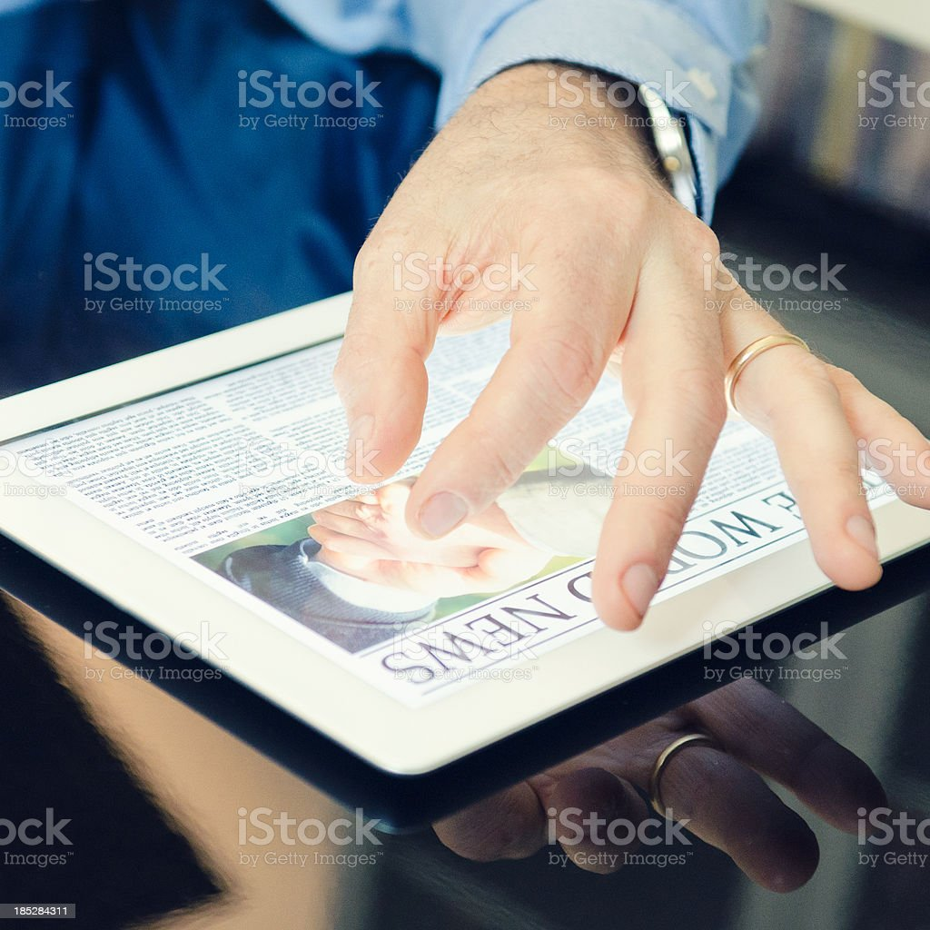 Business person reading a newspaper on digital tablet royalty-free stock photo