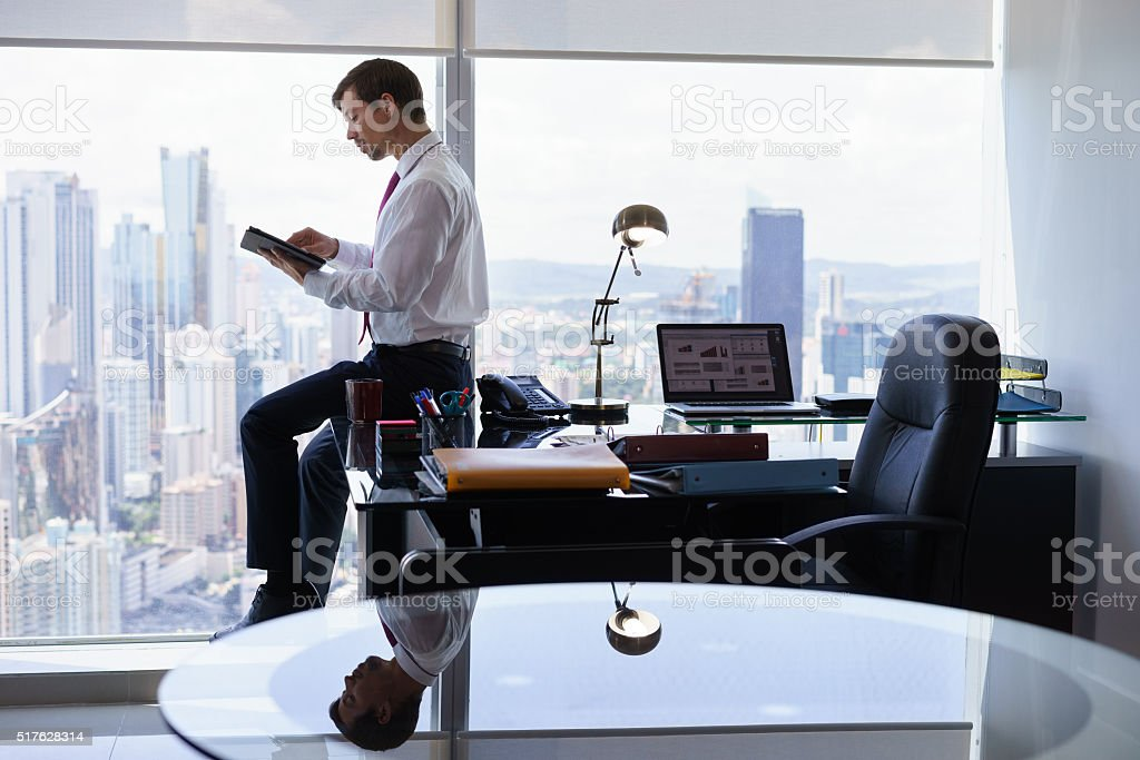 Business Person Reads News On Tablet PC In The Morning stock photo