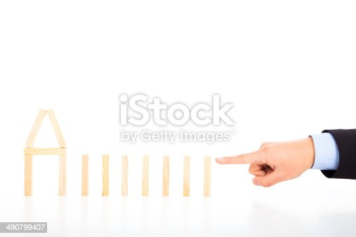 istock business person ready to push dominoes in a row 490799407