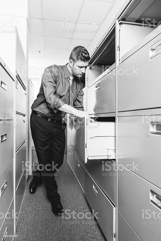 Business person searching in filing cabinets royalty-free stock photo