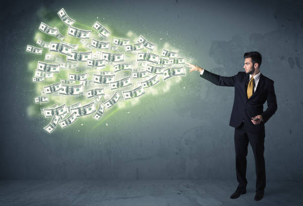 business person throwing a lot of dollar bills concept - throw money away stock pictures, royalty-free photos & images