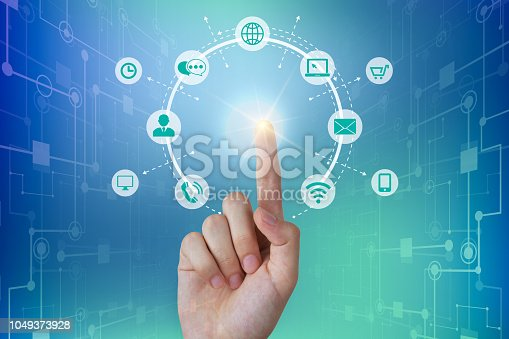 istock Business person touching a global network connection, communications concept 1049373928