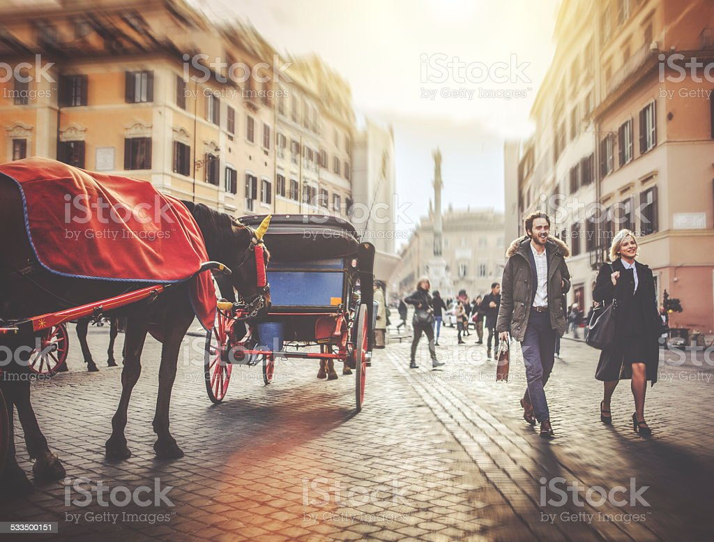 Business person walking at Piazza di Spagna in Rome stock photo