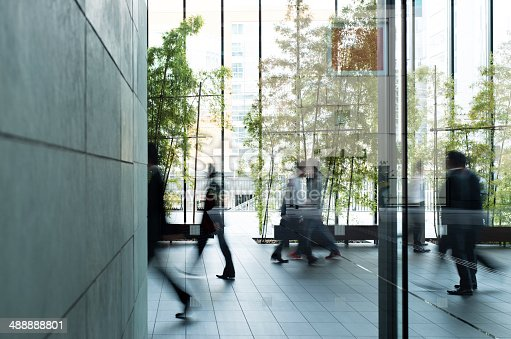 istock Business person walking in a urban building 488888801