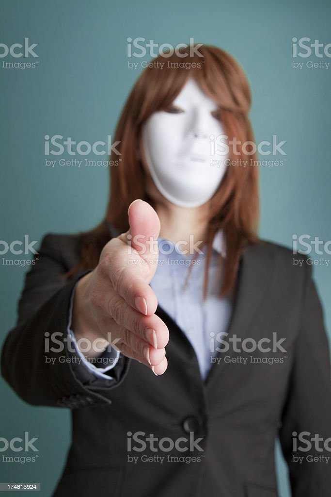 Business Person Wearing Mask Extending Hand For Handshake royalty-free stock photo