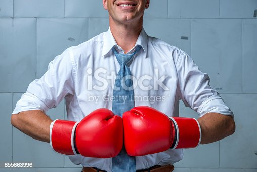 464164875 istock photo business person wearing white shirt, tie and boxing gloves 855863996