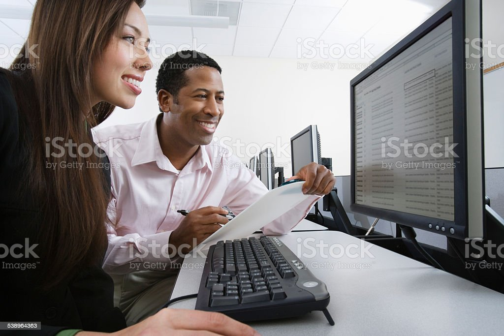 Business person working at computer stock photo