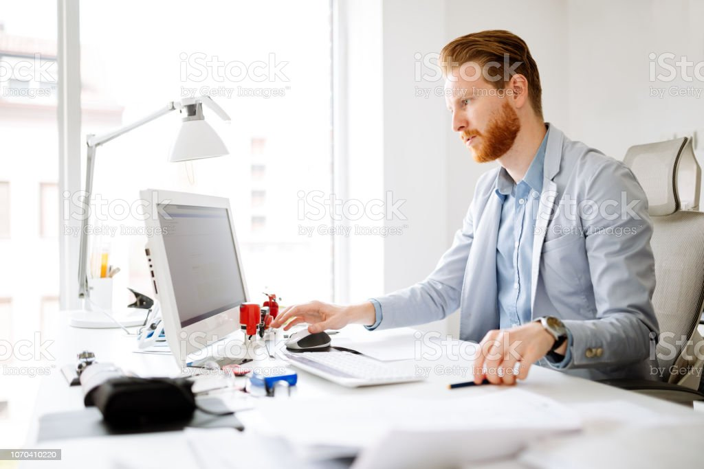 Business person working on computer stock photo