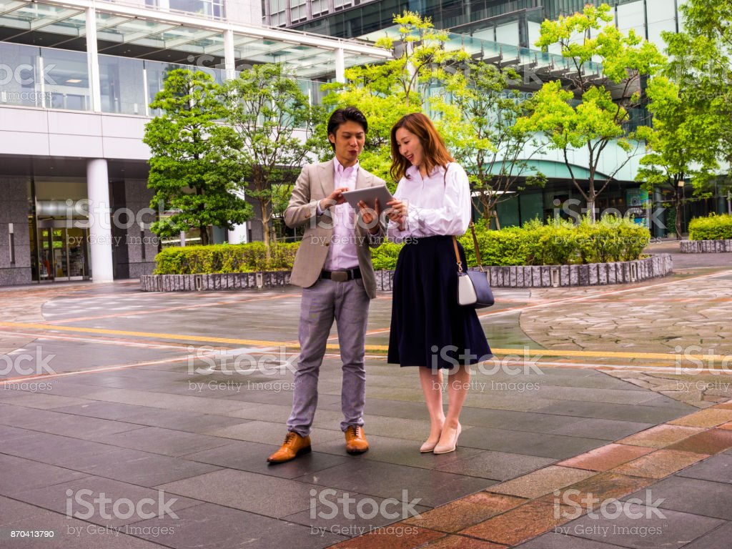business persons checking on the tablet PC. stock photo