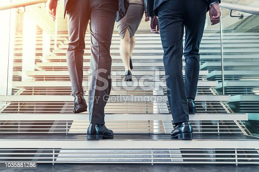 istock Business persons going up the stairs. 1035881286