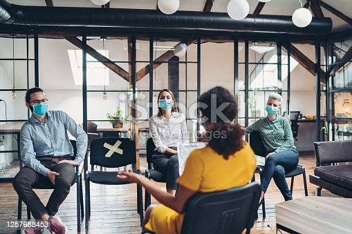 Business persons with protective masks during a meeting in the office