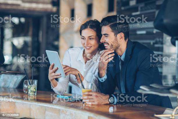 Business persons with digital tablet and drinks in hotels lobby picture id672506868?b=1&k=6&m=672506868&s=612x612&h=qspf4gpjtcxfcnt2mlc5i6ktth rbmya1hqxy0rpm9q=