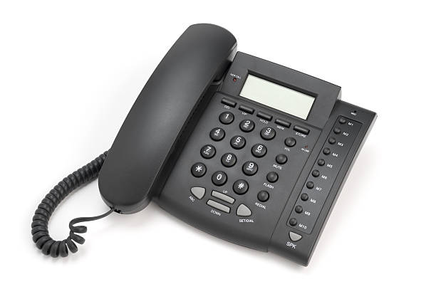 Business phone Modern digital black IP phone isolated on white. Related images: conference phone stock pictures, royalty-free photos & images