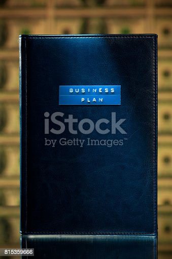 815359666 istock photo business plan book 815359666