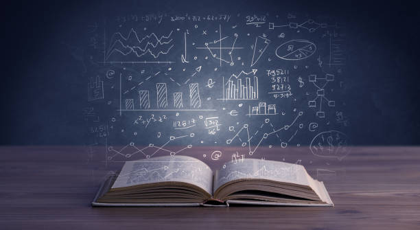 Business plan over book stock photo